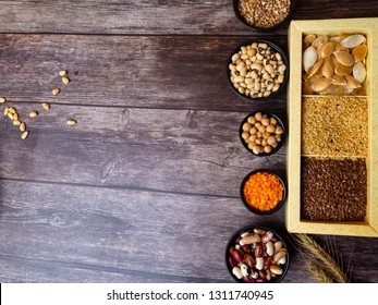 bean seeds, lentil, peas on wooden table, healthy rich with fiber food, food rich in vitamin A, E, B, K, Mg calcium, phosphorus, iron