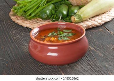 bean soup and fresh ingredients for cooking on the table