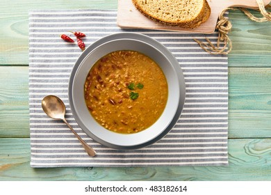 bean and spelt soup on a wooden table, bright colors