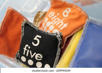 Beanbags for juggling and throwing. A group of numbered and square toy beanbags .