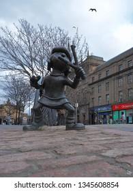 Beano Minnie.  Dundee, Scotland - February 18, 2019 Monument to the hero of British comics Beano Minnie in the center of the Scottish city of Dundee.