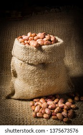 Beans in a bag on the background of burlap