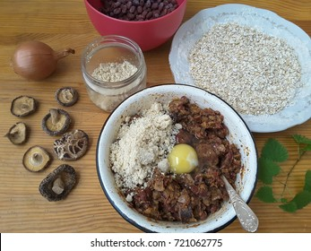 Beans burgers with mushrooms shiitake and oats cooking healthy vegetarian spicy food, spices