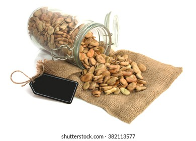 Beans in glass jar isolated over white