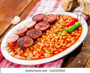 Beans with grilled sausage, traditional european homemade meal