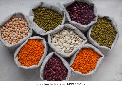 beans, lentils, peas, soybeans in bags on a white background close-up. Keto diet. Natural Vegetarian Food. superfood. Zero waste.