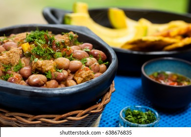 Beans with pork meat served with avocado and patacon