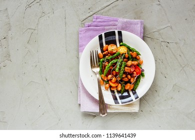Beans vegan salad with aspargus, micro greens and tomatoes flat lay. Tasty energy boosting salad plate on light background. Clean eating, superfood, vegan, detox food concept. Top view