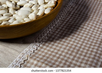 Beans in a wooden plate on the table