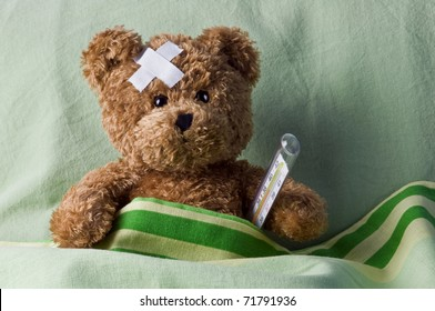 bear in bed with thermometer and plaster