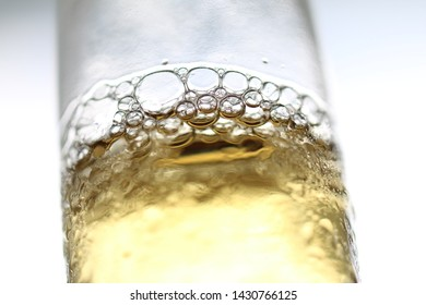 Bear bottle with bubbles, yellow colored.
