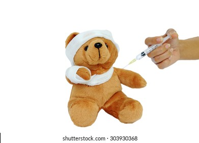 Bear doll with gauze wrapped the head, arms and are being injected.