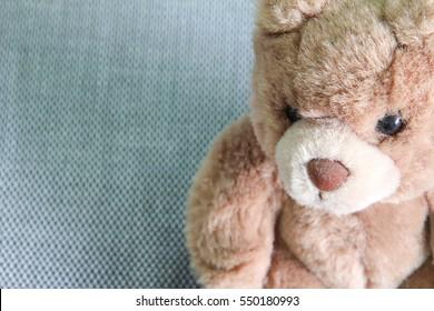 bear doll sitting on floor 2