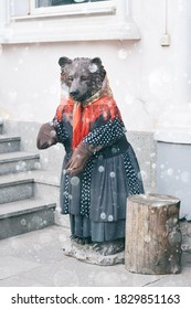 Bear figure in clothes under the snow