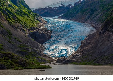 The Bear Glacier and Strohne Lake in the United states of America illuminated by the first sun rays, between Hyder in Alaska and Stewart in British Columbia, Canada, Kenai fjords national park.