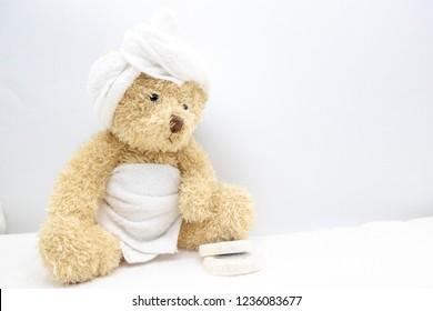 Bear golfer wears white towel is going to shower in bathroom