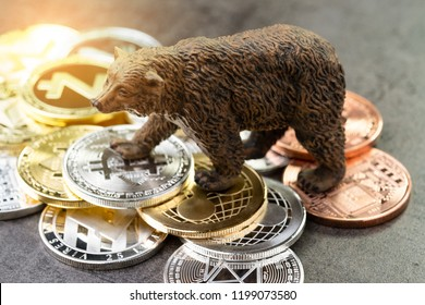 Bear market of crypto concept, price down or falling demand collapse of crypto currency, bear figure standing on bitcoin and various of cryptocurrency physical coins.