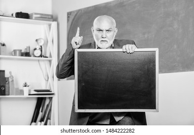 bear in mind. exam and graduation results. information is here. senior man teacher with empty blackboard. place for copy space. Mature teacher man hold chalk board. back to school. Education concept.