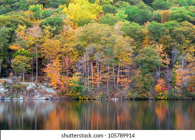 Bear Mountain with Hudson River in Autumn with colorful foliage and water reflection.