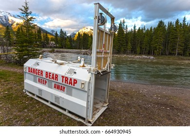 Bear Trap Metal Cage by Bow River in Town of Canmore Alberta Canada at Foothills of Rocky Mountains in Springtime