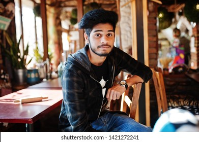 Beard asian man in casual wear sitting indoor cafe.