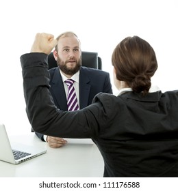 beard business man brunette woman at desk arms in the air
