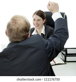 beard business man brunette woman at desk raise arms in the air