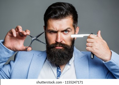 Beard man, bearded male. Portrait beard man. Barber scissors and straight razor, barber shop, suit. Vintage barbershop, shaving. Mustache men. Beard macho man. Brutal guy, scissors, straight razor.