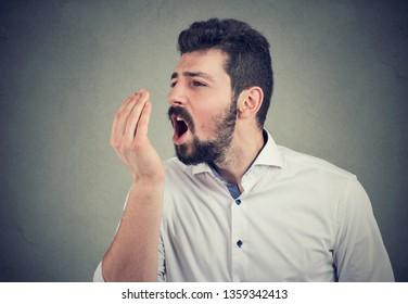 Beard man doing a hand breath test