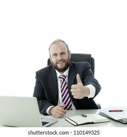 beard man thumb up at the desk