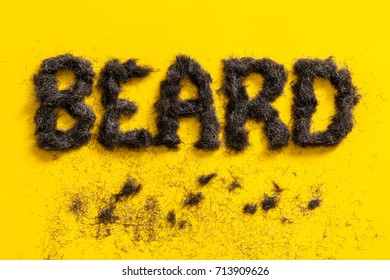 Beard sign made in beard trimming angled on a bright yellow background