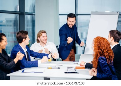 bearded boss leader coaching and teaching in modern office. On job training. Business and Education concept