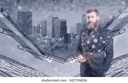 Bearded businessman in dark suit using smartphone with double exposure of social network interface