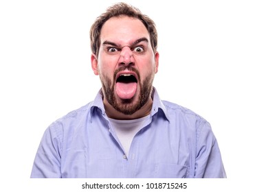 Bearded businessman screams with open mouth