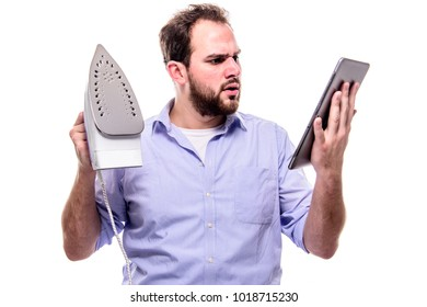 Bearded businessman searches online manual on iron or ironing clothes