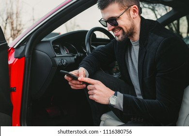 Bearded businessman using cell phone, bearded man in stylish jacket, man in sunglasses, man in luxury car, hairstyle, pretty, attractive, rich, hand watch, jeans, busy, phone work, designer, happy