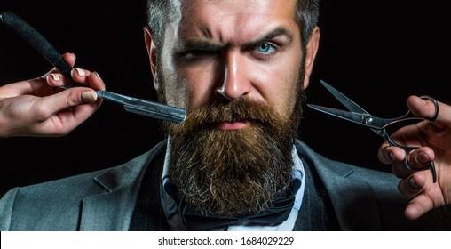 Bearded client visiting barber shop. Barber scissors and straight razor, barber shop, suit. Vintage barber shop, shaving. Portrait bearded man. Mustache men. Brutal guy, scissors, straight razor.