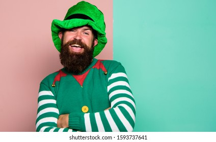 Bearded elf. Winter carnival. St Patricks day. Hipster with beard wearing green costume for party. Cheerful man celebrate holiday. Christmas elf. Elf concept. Traditions or customs. Happy celebration.