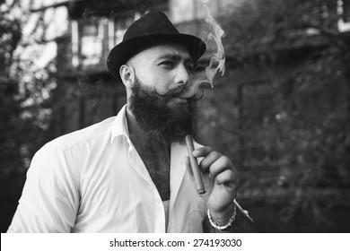 bearded gangster smoking cigar, black and white