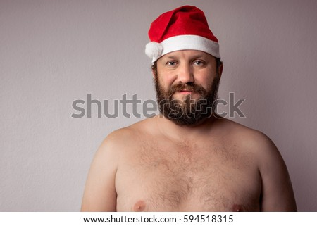 f85bf3b42200d Bearded half-naked Santa Claus with a long beard in Christmas or Xmas New  Year