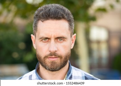 Bearded for her pleasure. Bearded man on urban background. Unshaven guy with bearded face. Handsome caucasian adult wear mustache and beard hair. Trendy hairstyle for bearded man. Barbershop.