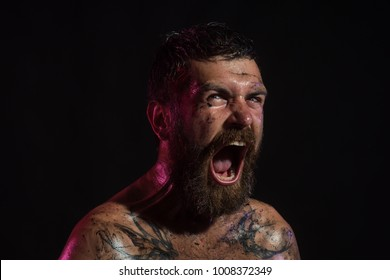 Bearded hipster with angry face shout on black background. Halloween holidays celebration. Wizard, sorcerer, warlock. Magic, enchantment, witchcraft.