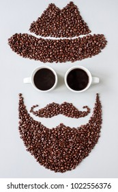 Bearded hipster man in hat made of coffee beans with glasses made of cups of coffee.