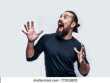 bearded hipster man smiling into camera. Hipster man with beard  having cheerful look. Positive emotions.Crazy emotions. joy. Hipster wearing black blank t-shirt with space for your logo.