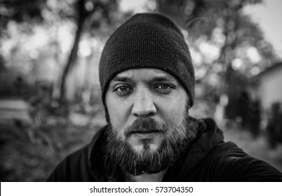 babc185e7a9 Bearded, homeless, caucasian man, in his thirties, wearing a beanie hat,