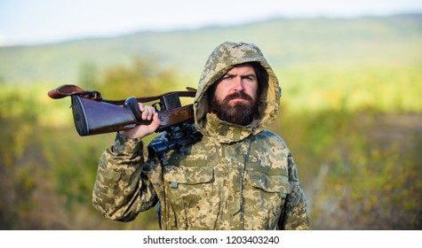 Bearded hunter rifle nature background. Hunting big game typically requires tag each animal harvested. Experience and practice lends success hunting. Hunting season. Guy hunting nature environment.