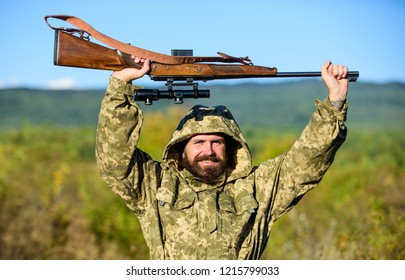 Bearded hunter rifle nature background. Harvest animals typically restricted. Hunting hobby concept. Experience and practice lends success hunting. Hunting season. Guy hunting nature environment.