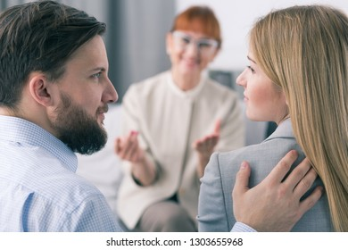 Bearded husband and blond wife reconcile after successful Psychotherapy session for marriage