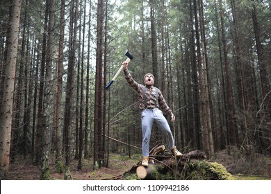 A bearded lumberjack with a large ax examines the tree before felling