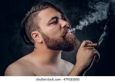 Bearded male smoking a cigarette.